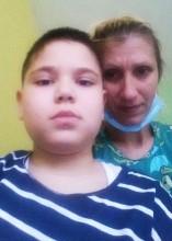 Micutul David pleaca la operatie in Italia! Au fost platiti 25.550 de euro pentru operatie